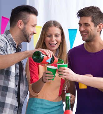 Three young people enjoying a fun party.
