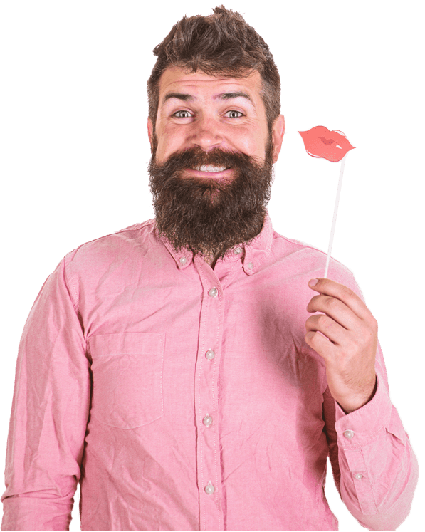 A happy man wearing a bright pink shirt, posing for a photobooth photo with a photo booth prop.